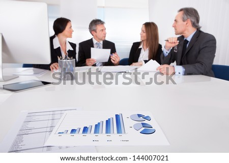 Portrait Of Business People Discussing Plan In Office