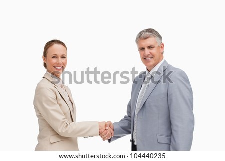 Portrait of business people shaking their hands against white background