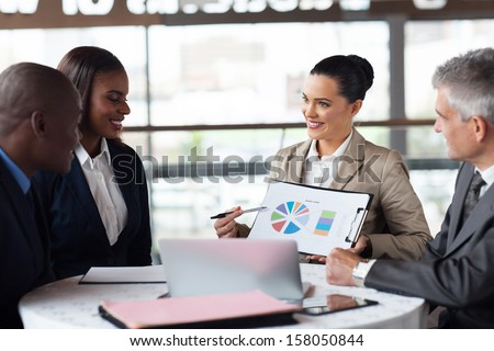 portrait of business team discussing market share in a meeting