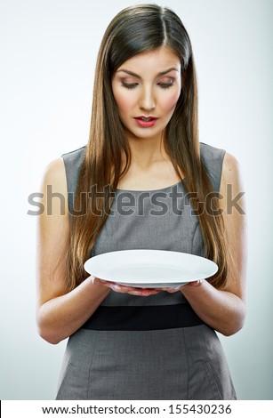portrait of business woman hold empty white plate. Business concept portrait.