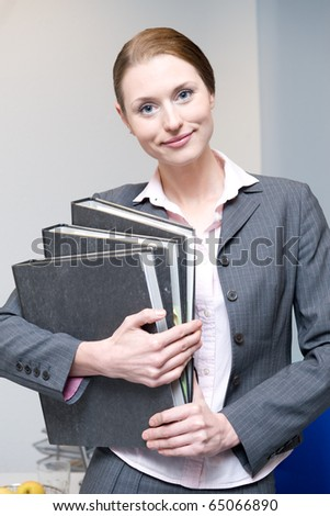 Portrait of business woman holding a folder