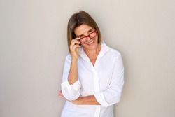 Portrait of business woman smiling and holding glasses