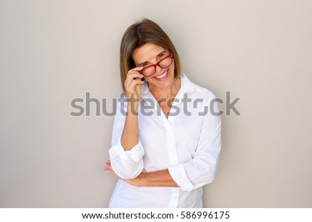 Portrait of business woman smiling and holding glasses #586996175