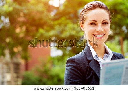 Portrait of business woman smiling outdoor #383403661