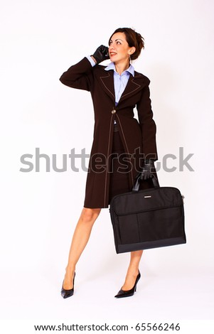 Portrait of business woman talking on the cell phone