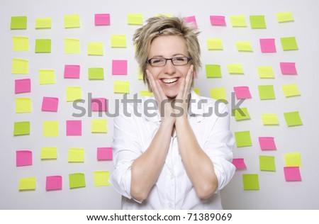Portrait of business woman with note papers