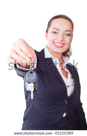 Portrait of business woman with the keys on a light background. Focus on key