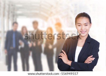 portrait of business women call center or female customer support phone operator 20-30 years old and business team has blur office background ,has confidence in providing good service and friendly.