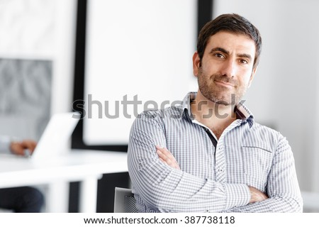 Portrait of businessman #387738118