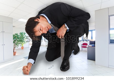 Portrait of businessman in a small office