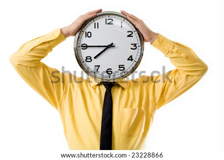 Portrait of businessman?s hands touching clock placed instead of head
