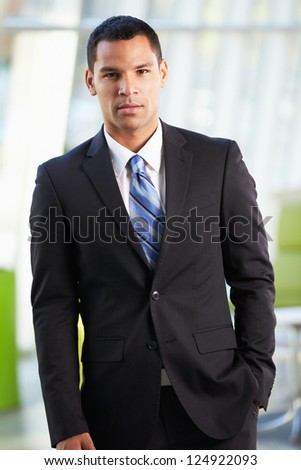 Portrait Of Businessman Standing Modern Office Reception