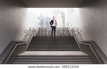 Portrait of businessman standing with his hands on the waist on the stairs leading to city street. Concept of good prospects. 3d rendering. #508512256