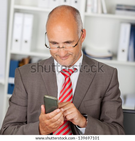portrait of businessman using smartphone in the office