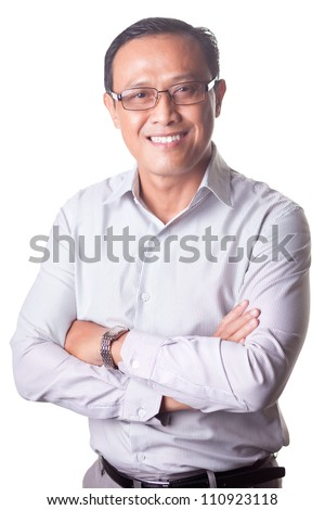Portrait of businessman wearing glasses looking at camera on white background