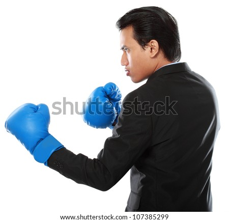 portrait of businessman with boxing glove punching - stock photo