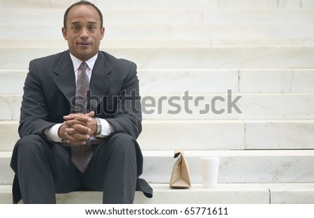 Portrait of businessman with lunch