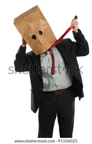 Portrait of businessman with paper bag on head pulling tie isolated over white background