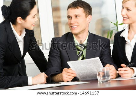 Portrait of businesspeople discussing business-plan in the office
