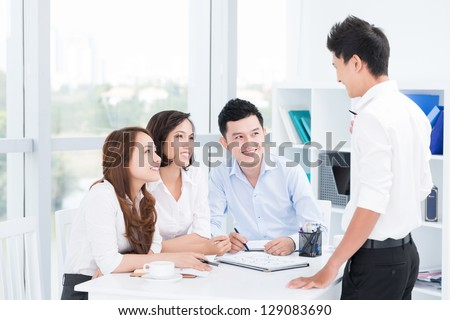 Portrait of businesspeople working at office