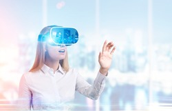 Portrait of businesswoman in virtual reality glasses working in her office. Concept of vr and cutting edge technology. Toned image.
