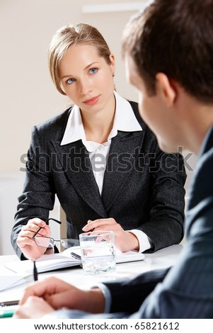 Portrait of businesswoman listening to her colleague attentively
