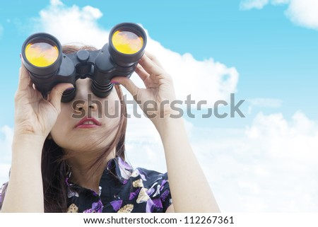 Portrait of businesswoman looking for an opportunity using binoculars