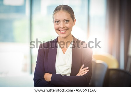 Portrait of businesswoman standing in the office #450591160