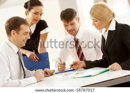 Portrait of busy people discussing new project or working plan - stock photo