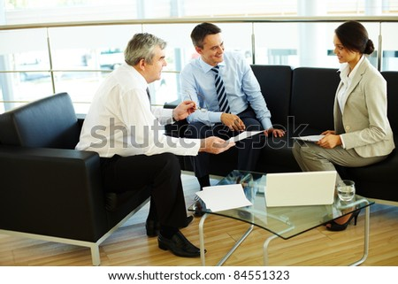 Portrait of busy people discussing new working plan at meeting