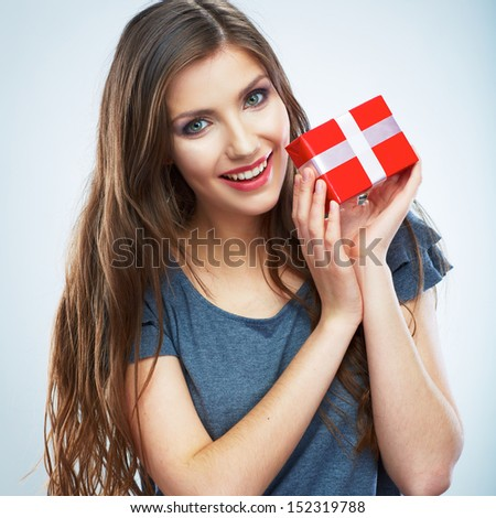 Portrait of casual young happy smiling woman hold red gift box. Isolated studio background female model.