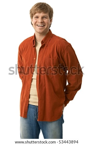 Portrait of casual young man in jeans and orange shirt smiling, isolated on white.