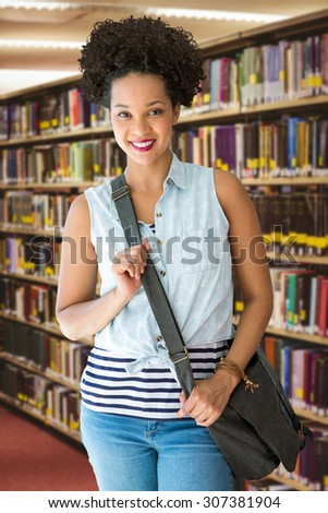 Portrait of casual young woman against close up of a bookshelf