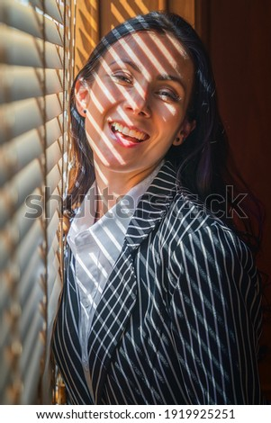 portrait of caucasian executive busineswoman being happy with smile standing by window in office