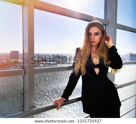 Portrait of Caucasian girl in business center.