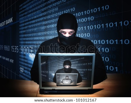 portrait of caucasian hacker with balaclava