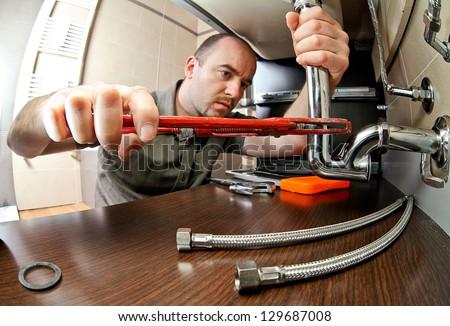 portrait of caucasian plumber at work