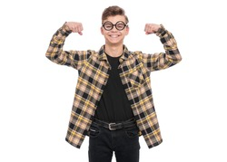 Portrait of caucasian teen boy in funny eyeglasses, isolated on white background. Funny teenager wearing plaid shirt showing off his biceps. Handsome child showing his hand biceps muscles strength.