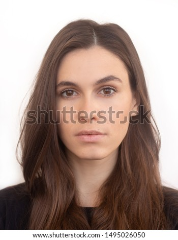 Portrait of caucasian woman with no expression. ID or passport photo full collection of diverse face and expressions. Calm interesting woman in black shirt with normal face expression