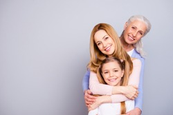 Portrait of charming beautiful friendly king supportive cute family members hugging each other isolated on gray background copyspace