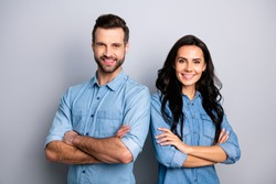 Portrait of charming charismatic freelancers entrepreneurs ready to solve business work problems take decisions. Wearing blue denim jackets isolated on ashy-gray background