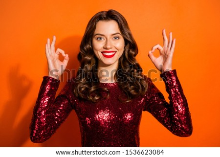 Portrait of charming positive girl show okay sign recommend ads adverts give her feedback wear good-looking clothes isolated over orange color background