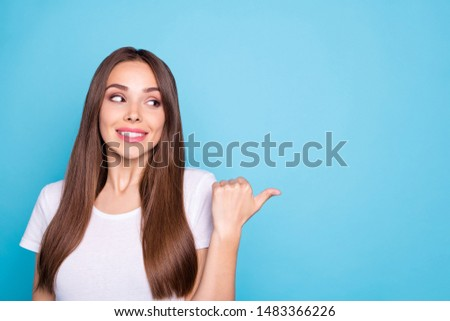 Portrait of charming promoter looking at copy space having advertisements isolated over blue background