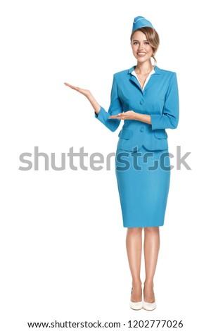 Portrait of charming stewardess wearing in blue uniform. Isolated on white background. Photo stock ©