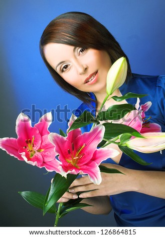 Portrait of charming woman with pink lilly