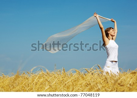 Portrait of charming young girl raising her hands with fabric