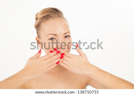 Portrait of charming young woman with red lips and manicure trying to keep silence