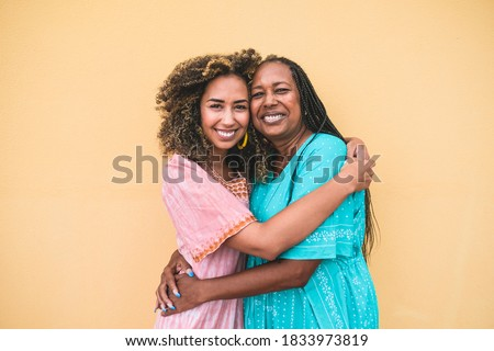 Portrait of cheerful african mother and adult daughter together - Family, mother and child love