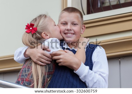 Portrait of cheerful and happy brother and sister, schoolboy and schoolgirl, outdoor #332600759