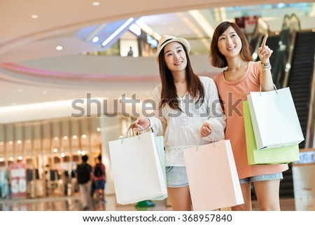 Portrait Of Cheerful Asian Girls Shopping In A Mall 368957840